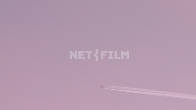 The plane flies in the sky Koktebel, plane, trail of the pink sky, the General plan, the flight of...