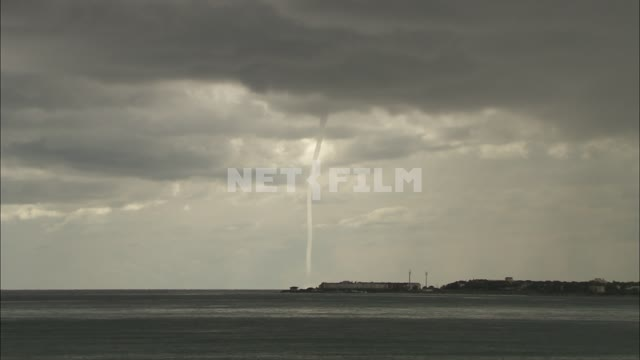 Waterspout over the sea. Tornado, sea, shore, tornadoes, clot, meso-hurricane.
